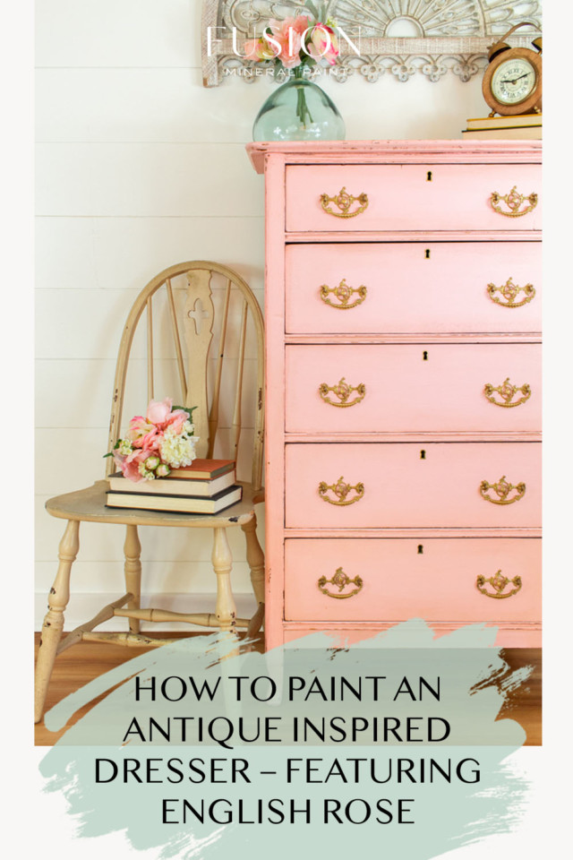 tall pink painted dresser with beige chair beside it