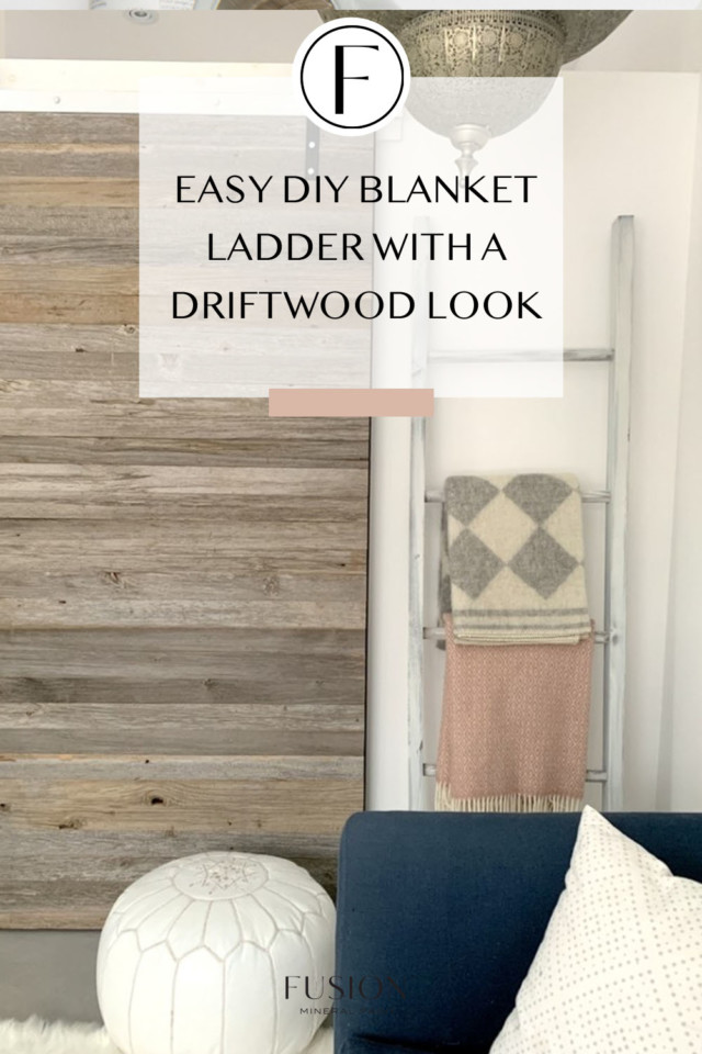image of blanket ladder beside wood feature wall