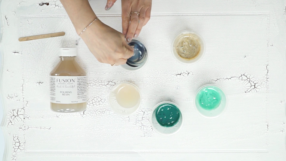 Did you know you can try paint pouring techniques on furniture? Using Fusion Mineral Paint and Fusion Pouring Resin, we made over a cabinet using beautiful shades of blue. Come check it out!