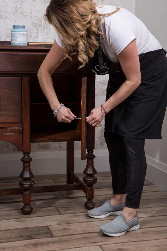 Jennylyn Pringle removing hardware from the sideboard