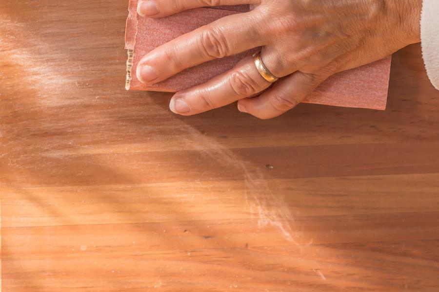 Sanding wooden bed
