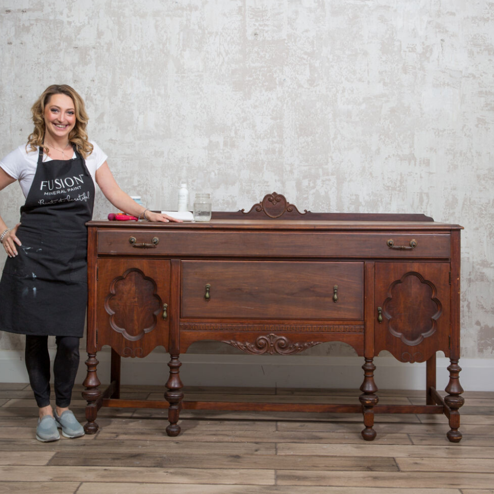 Jennylyn Pringle with brown before sideboard and supplies.