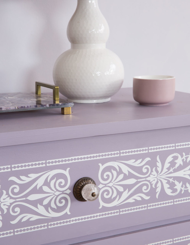 Close up of Raised pearl embossed stencil on Lavender painted laminate dresser