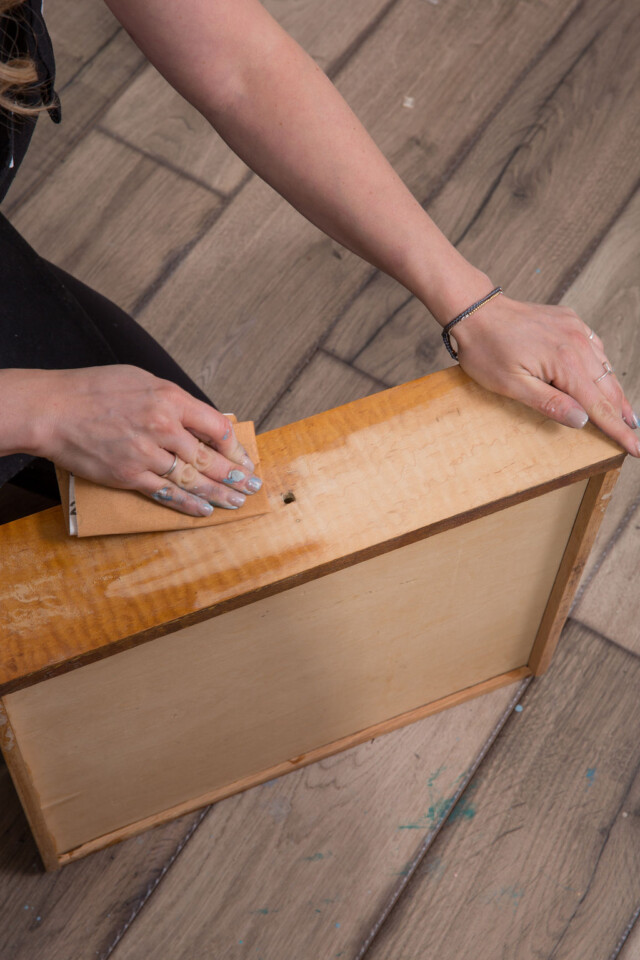 Sanding old finish off drawers