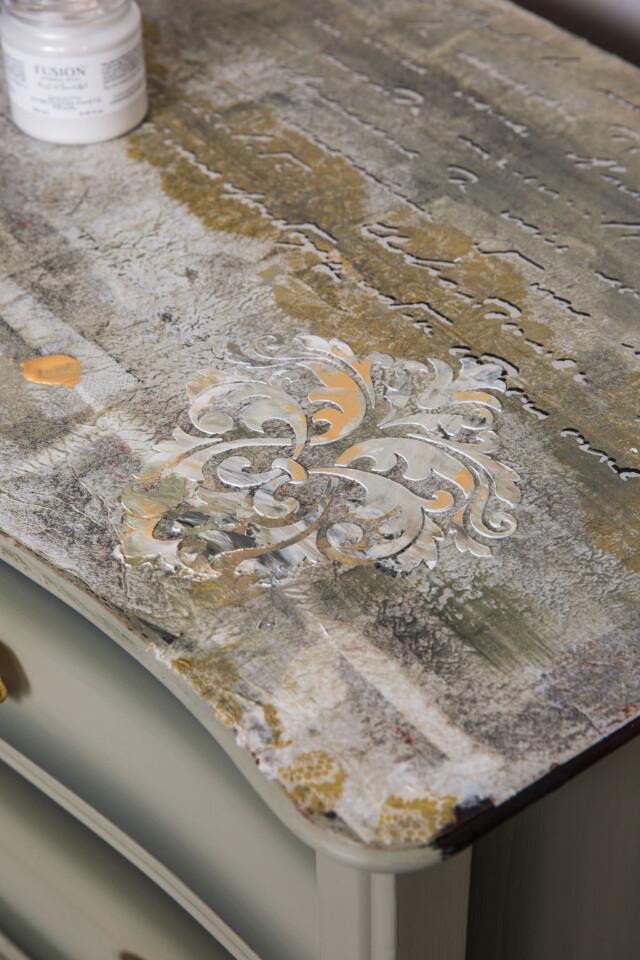 corner shot of finished raised embossing paste on ombre dresser