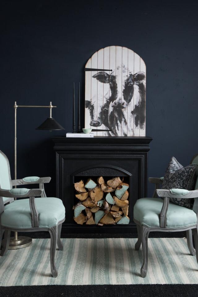 Statement chairs around a fireplace