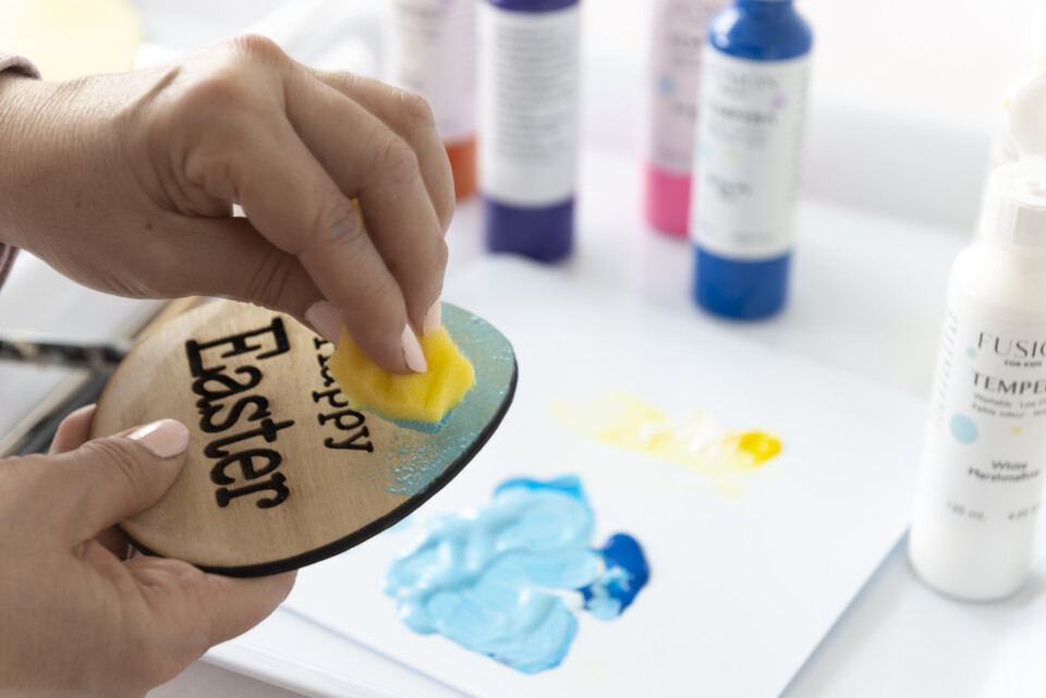 an egg being painted