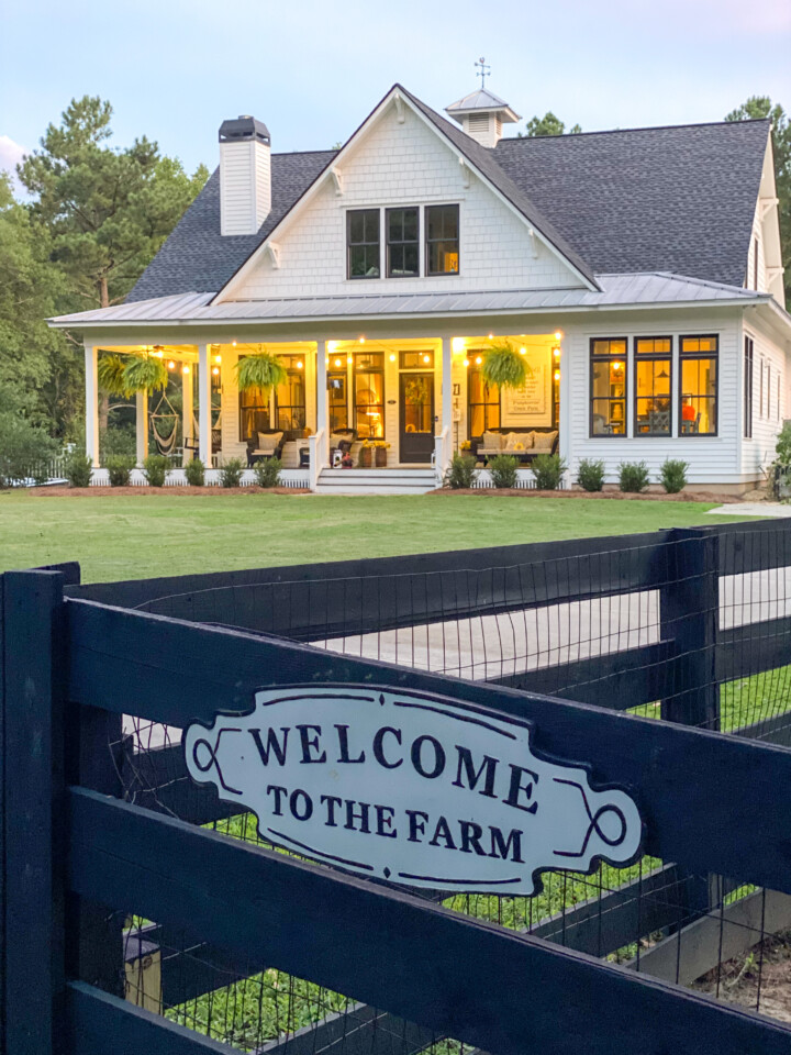 Farmhouse and gate with welcome sign