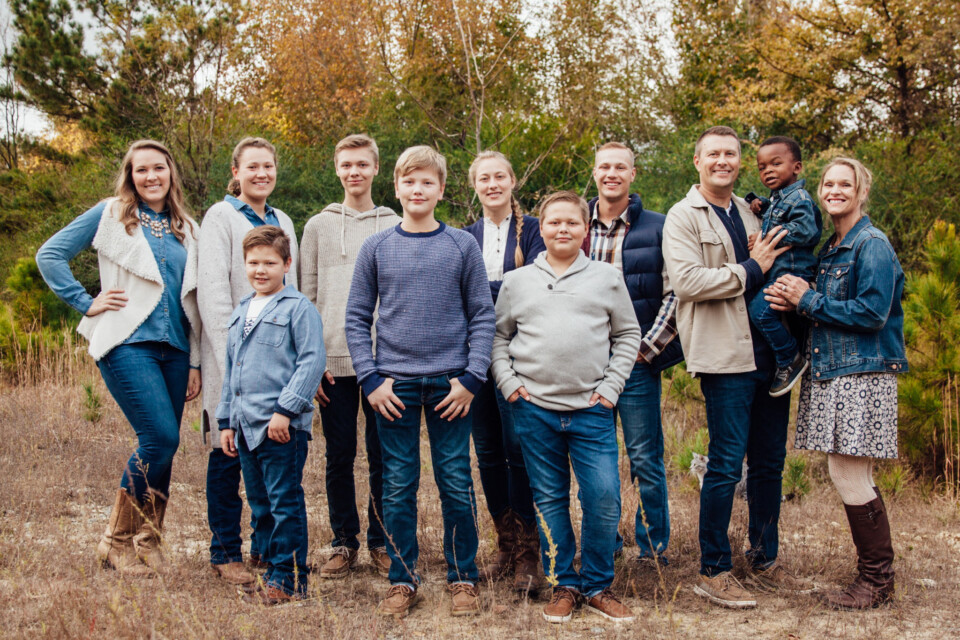 a family of 11 pictured in the woods