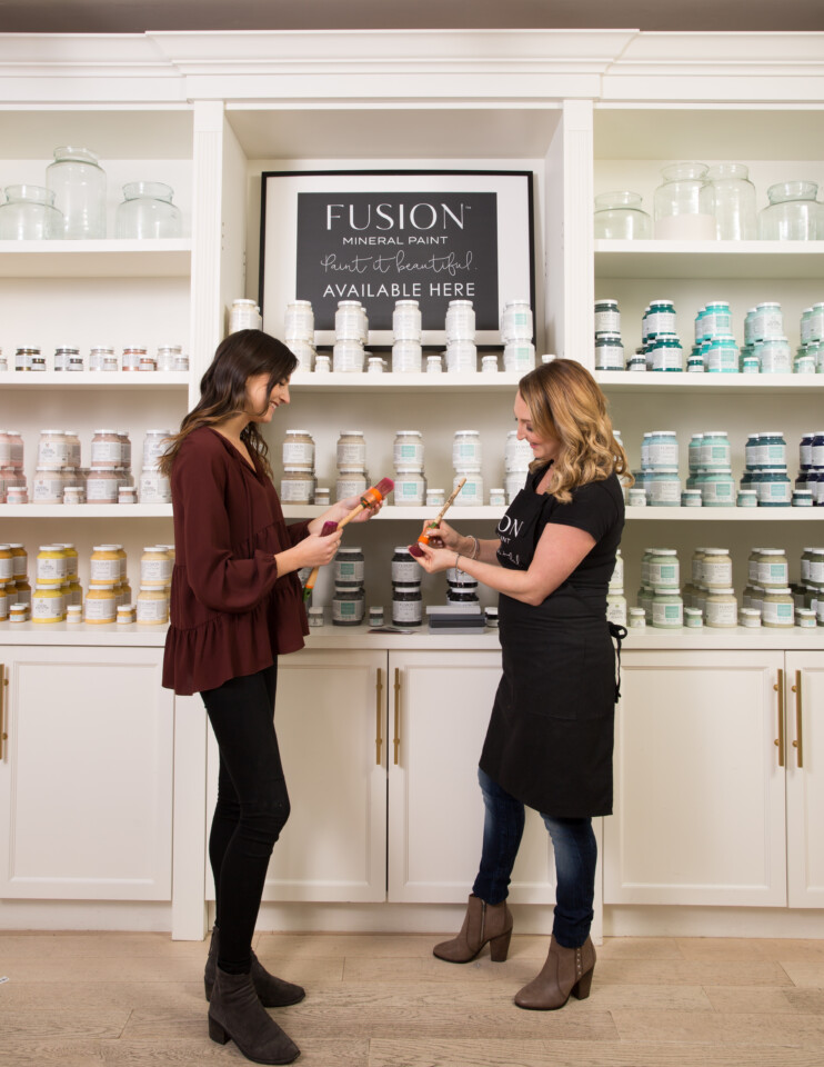 2 women in front of beautiful Paint display